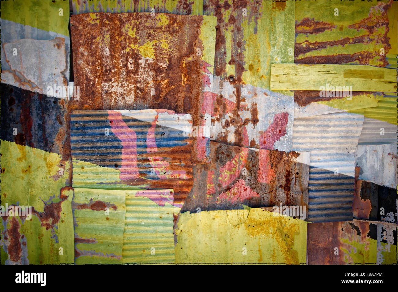 An abstract background image of the flag of Brunei painted on to rusty corrugated iron sheets overlapping to form - Stock Image