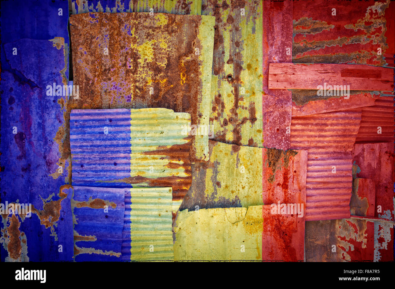 An abstract background image of the flag of Chad painted on to rusty corrugated iron sheets overlapping to form - Stock Image