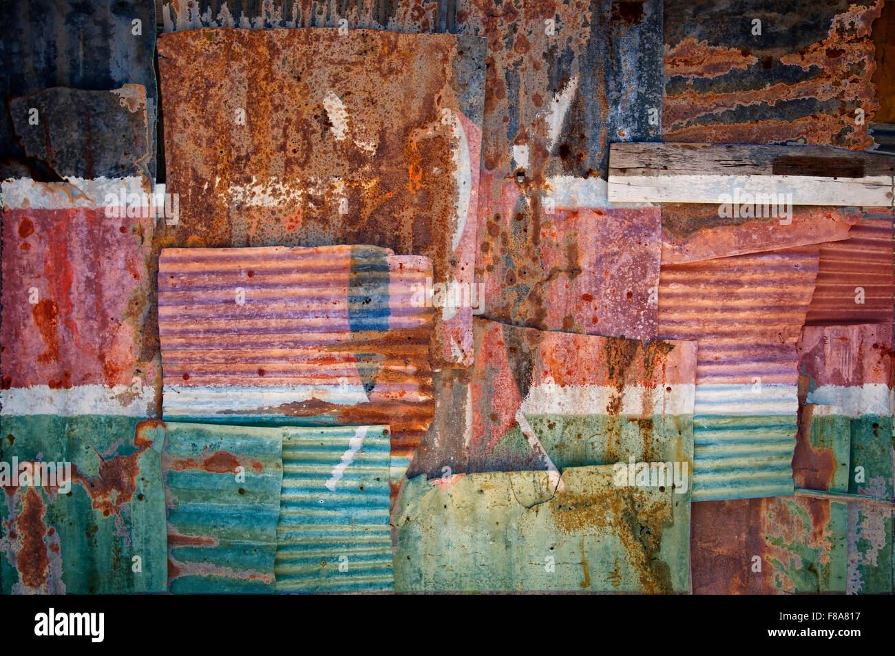 An abstract background image of the flag of Kenya painted on to rusty corrugated iron sheets overlapping to form Stock Photo