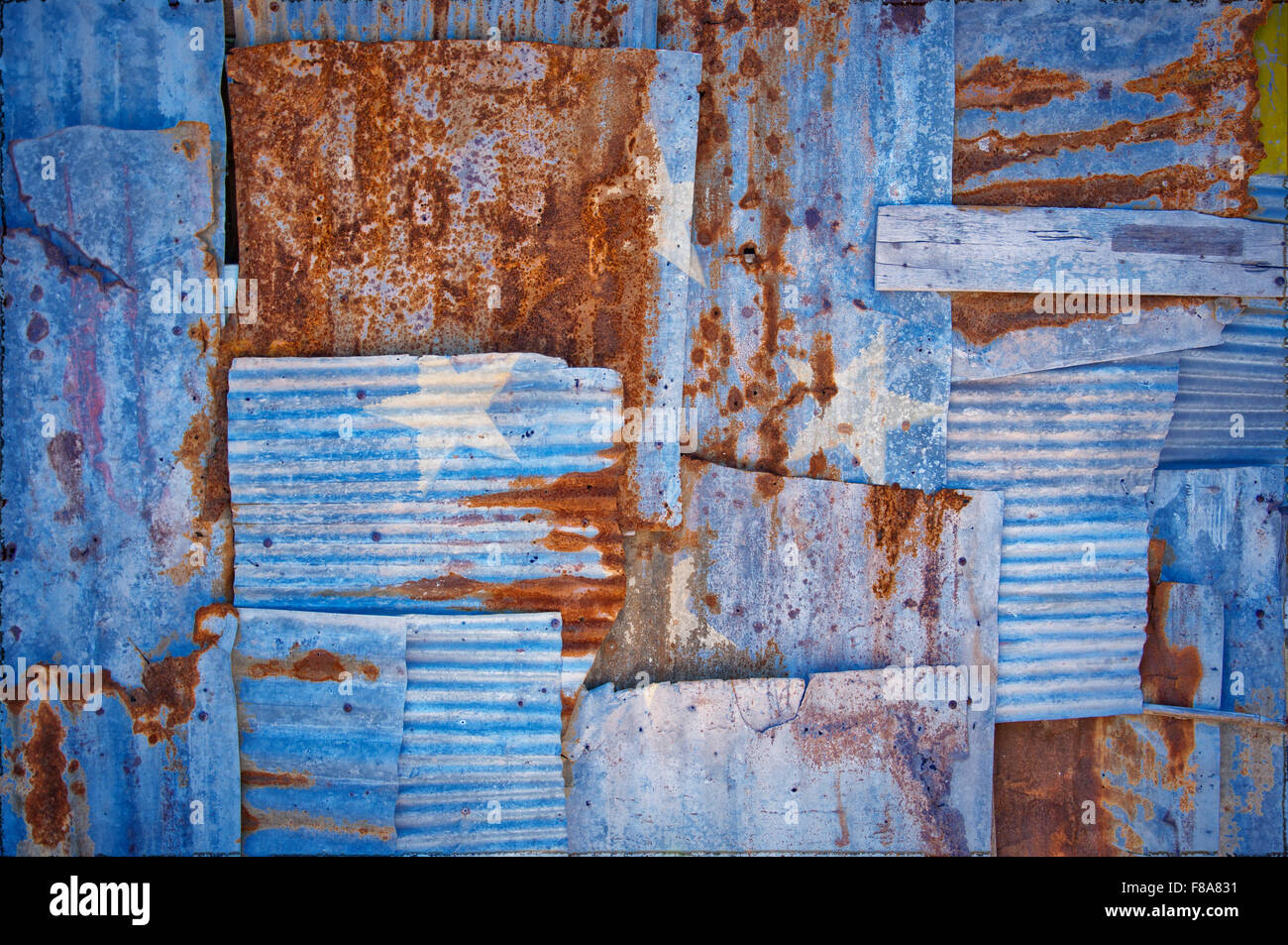 An abstract background image of the flag of Micronesia painted on to rusty corrugated iron sheets overlapping to - Stock Image