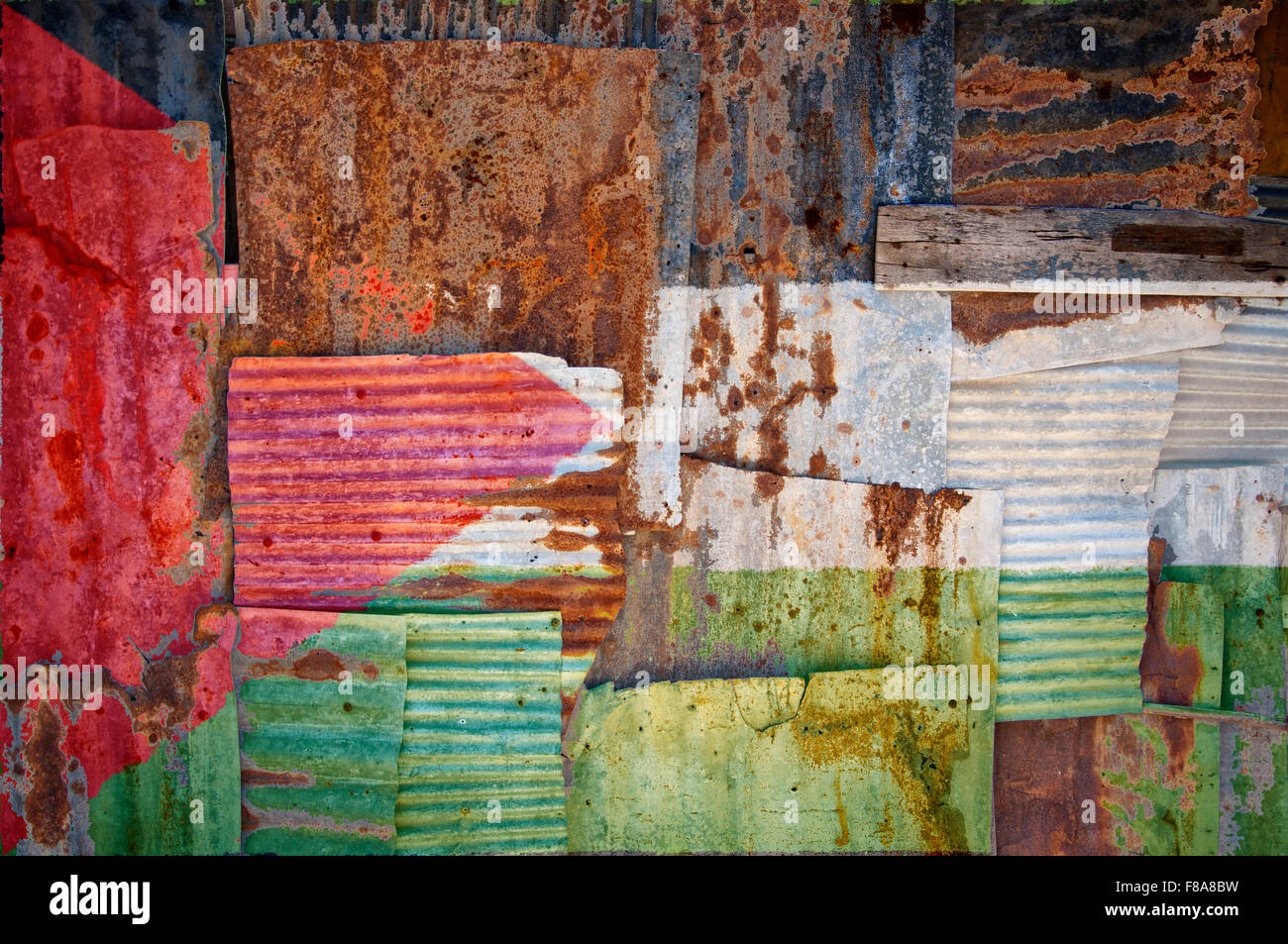 An abstract background image of the flag of Palestine painted on to rusty corrugated iron sheets overlapping to - Stock Image