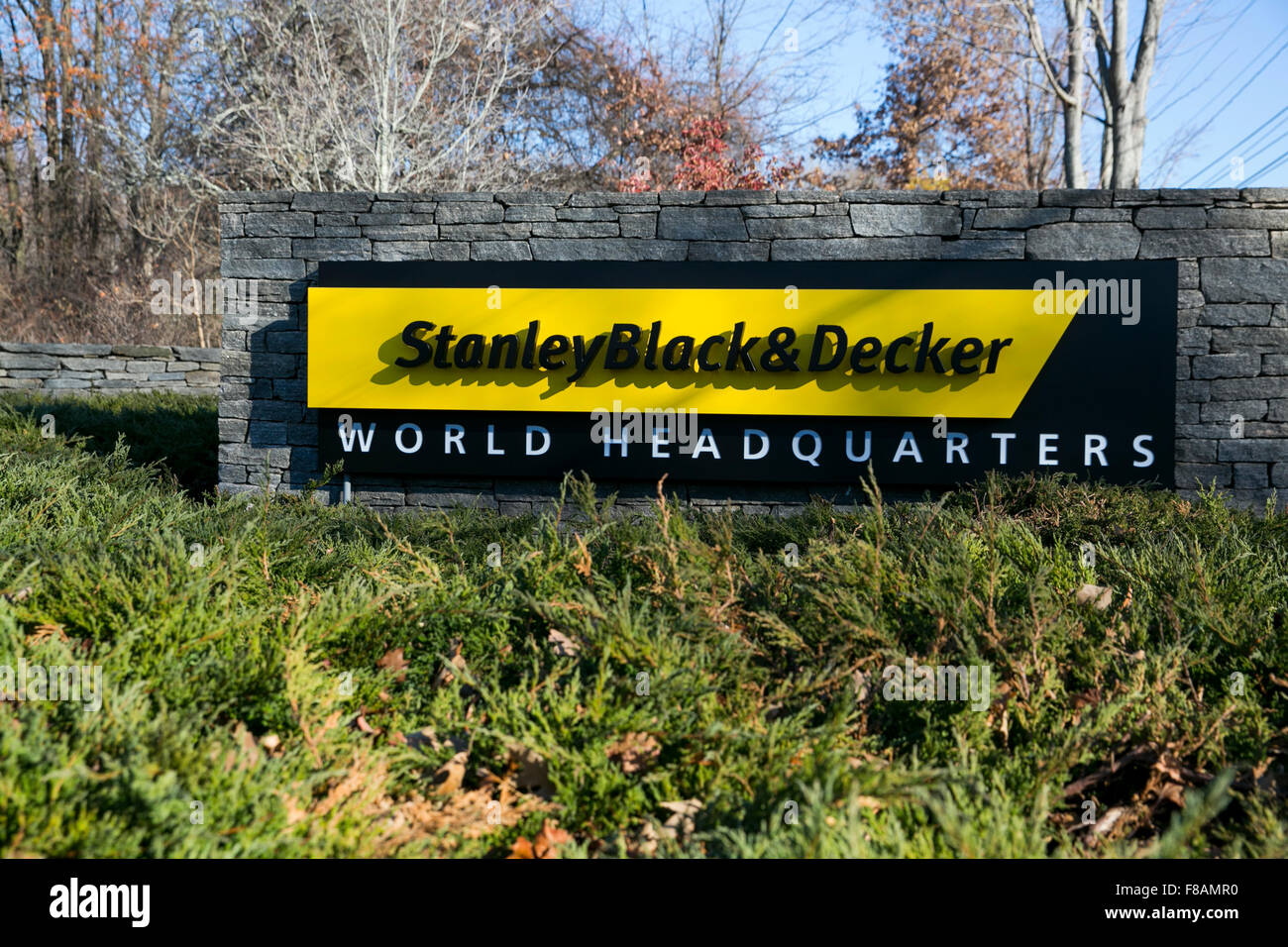 A logo sign outside of the headquarters of Stanley Black & Decker, Inc., in New Britain, Connecticut on November - Stock Image