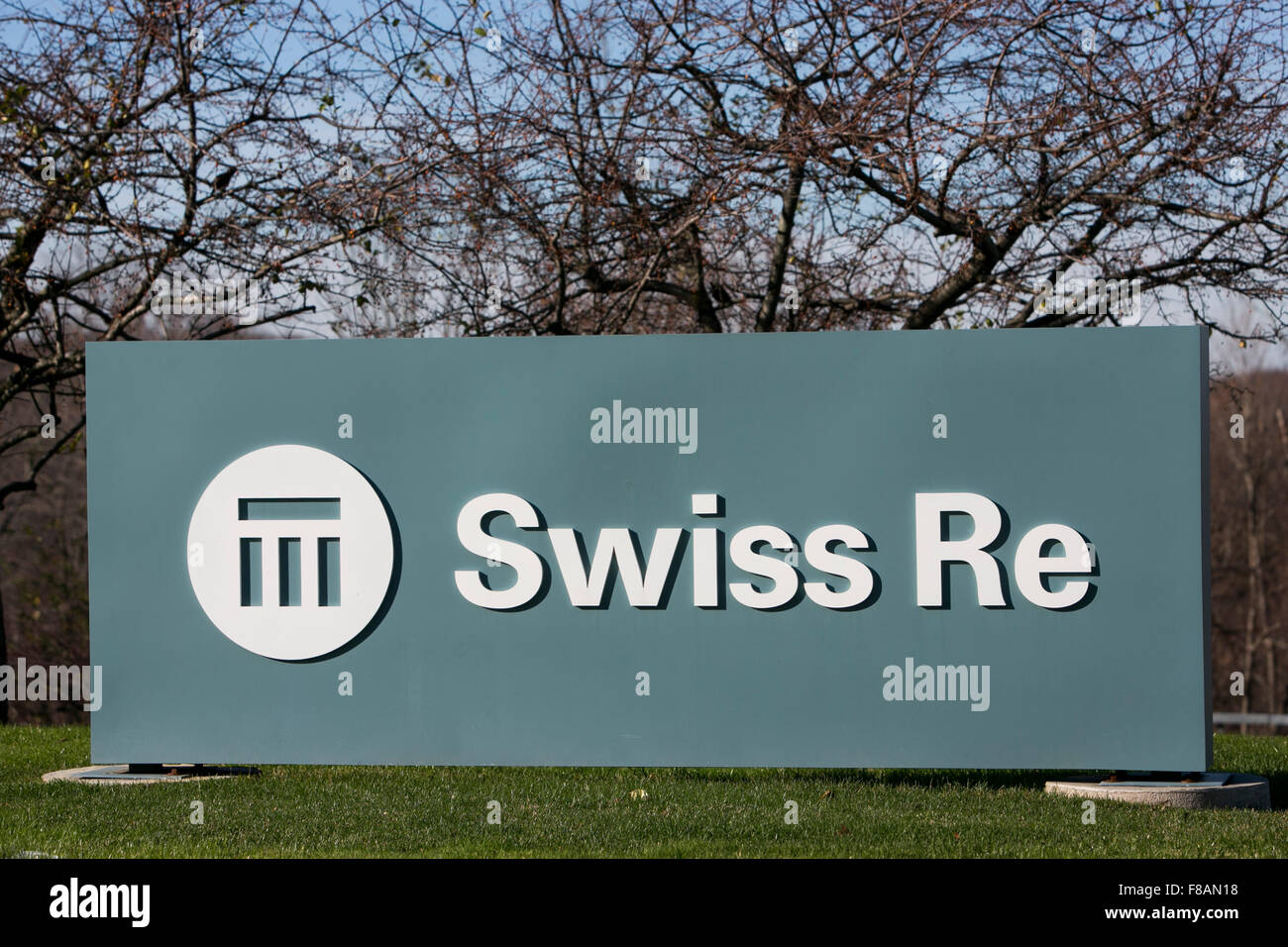 A logo sign outside of a facility occupied by Swiss Reinsurance Company, commonly known as Swiss RE, in Armonk, - Stock Image