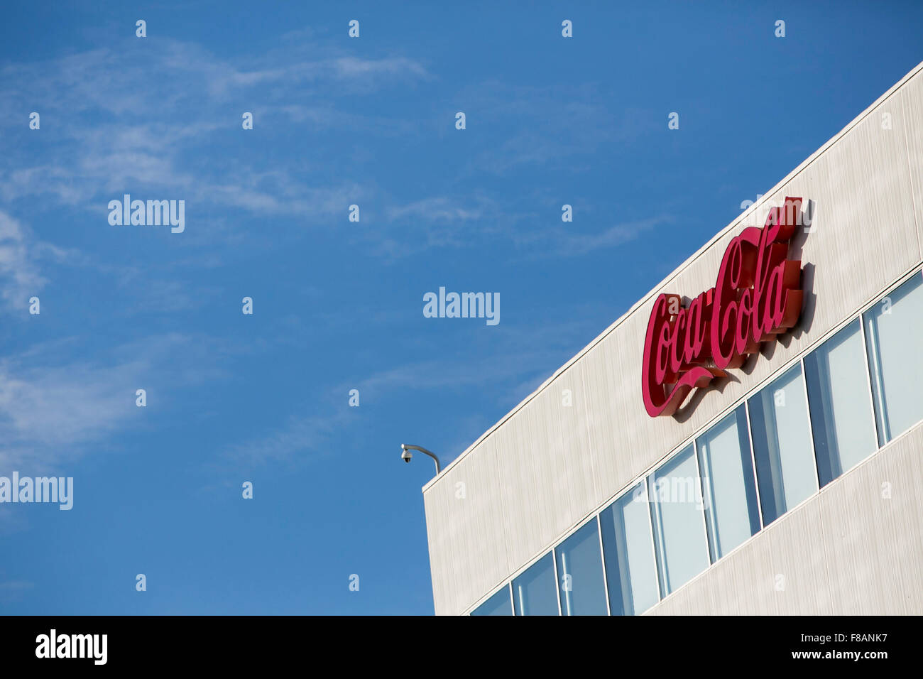 A logo sign outside of a facility occupied by Coca-Cola in Charlotte, North Carolina on November 28, 2015. - Stock Image