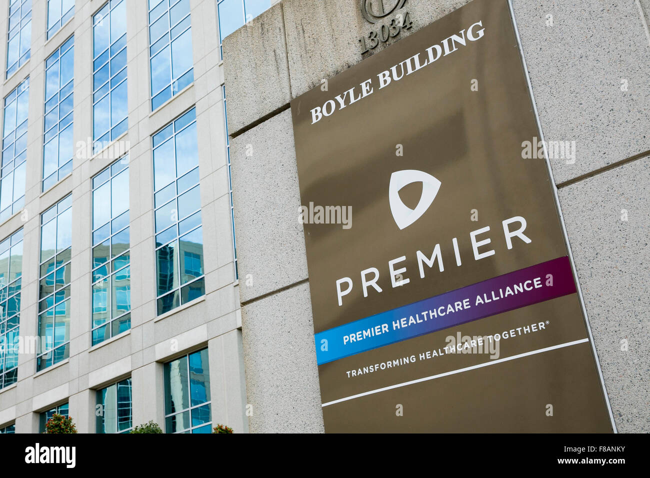 A logo sign outside of the headquarters of Premier, Inc., in Charlotte, North Carolina on November 28, 2015. - Stock Image