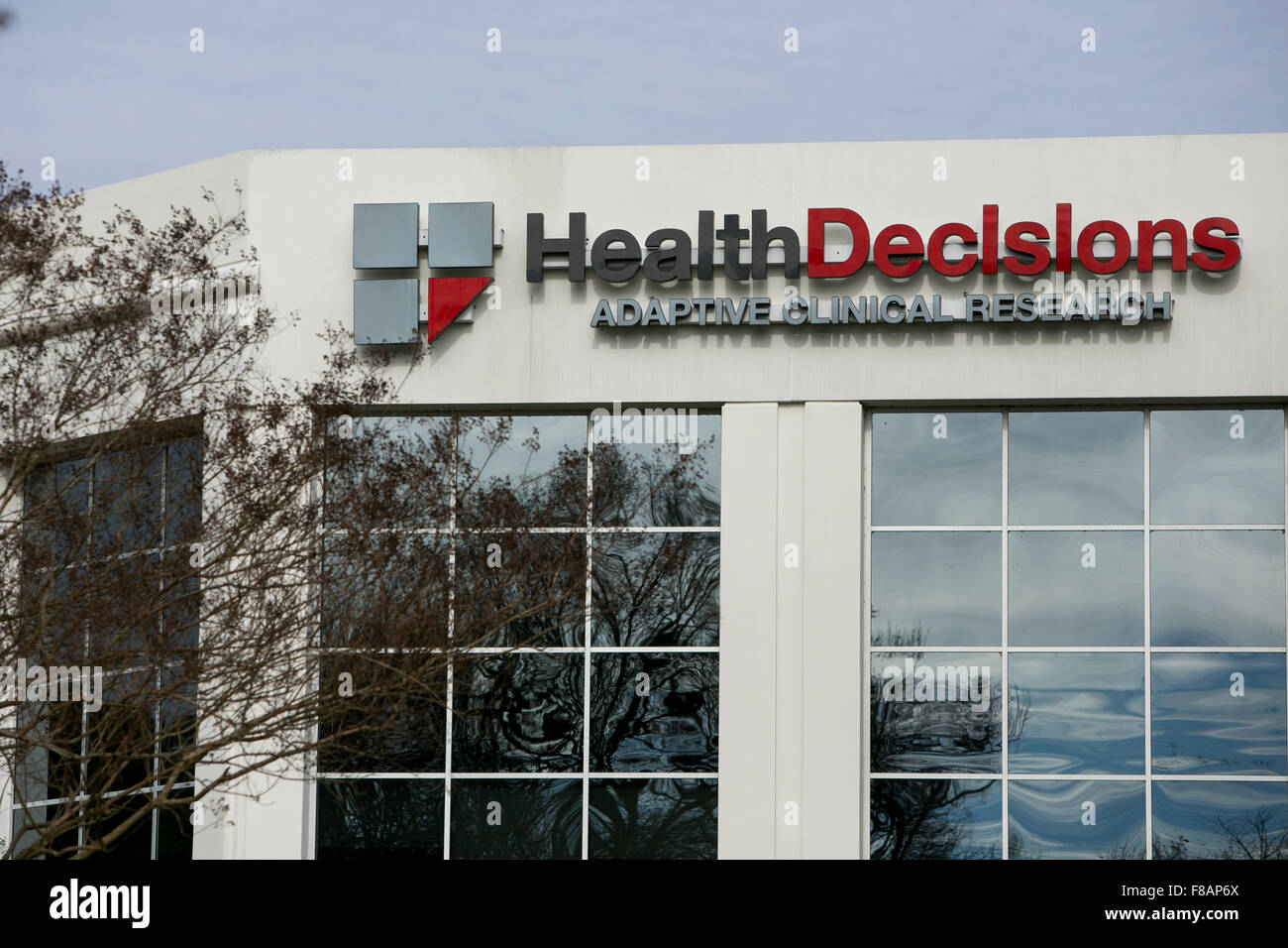 A logo sign outside of a facility occupied by Health Decisions Inc., in Durham, North Carolina on November 29, 2015. - Stock Image