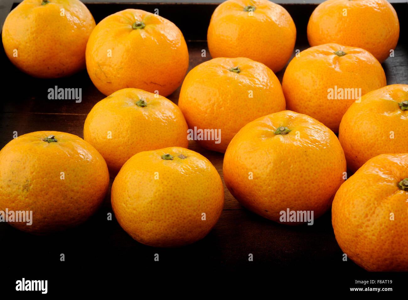 Mandarin orange in wooden tray - Stock Image