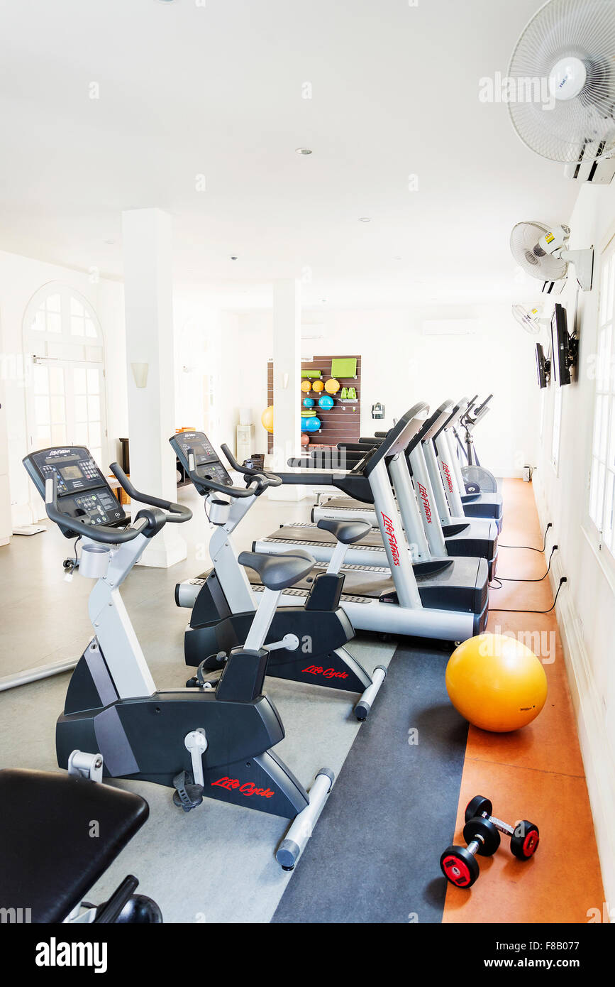 gym exercise fitness room with machines in hotel - Stock Image