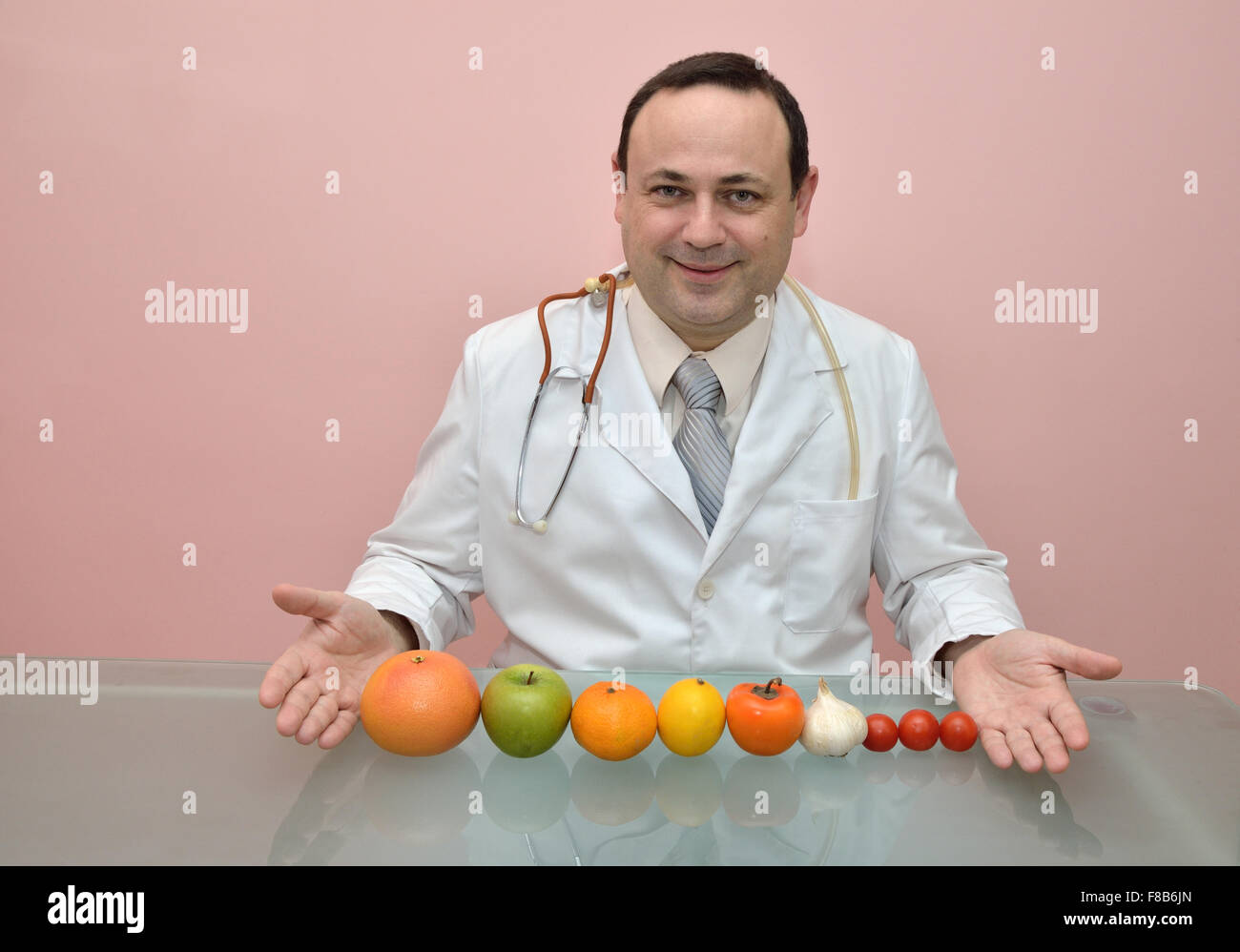 Doctor suggesting healthy fruits and vegetables Stock Photo