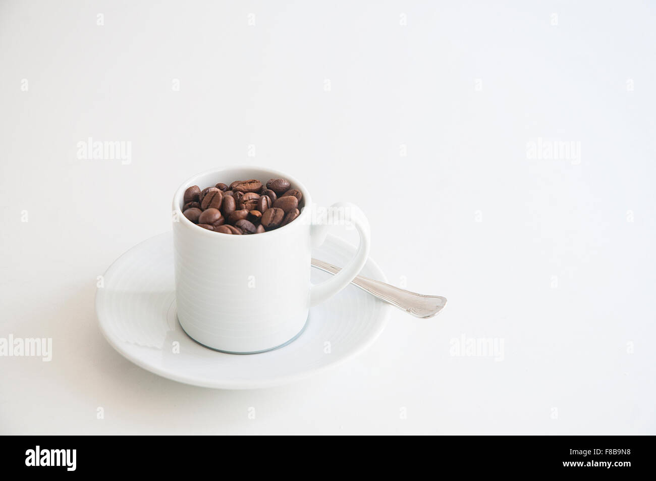 Cup with coffee beans. - Stock Image