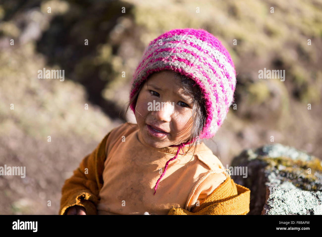 The Lares District of Peru. A young girl met by the photographer on a Lares trek - Stock Image