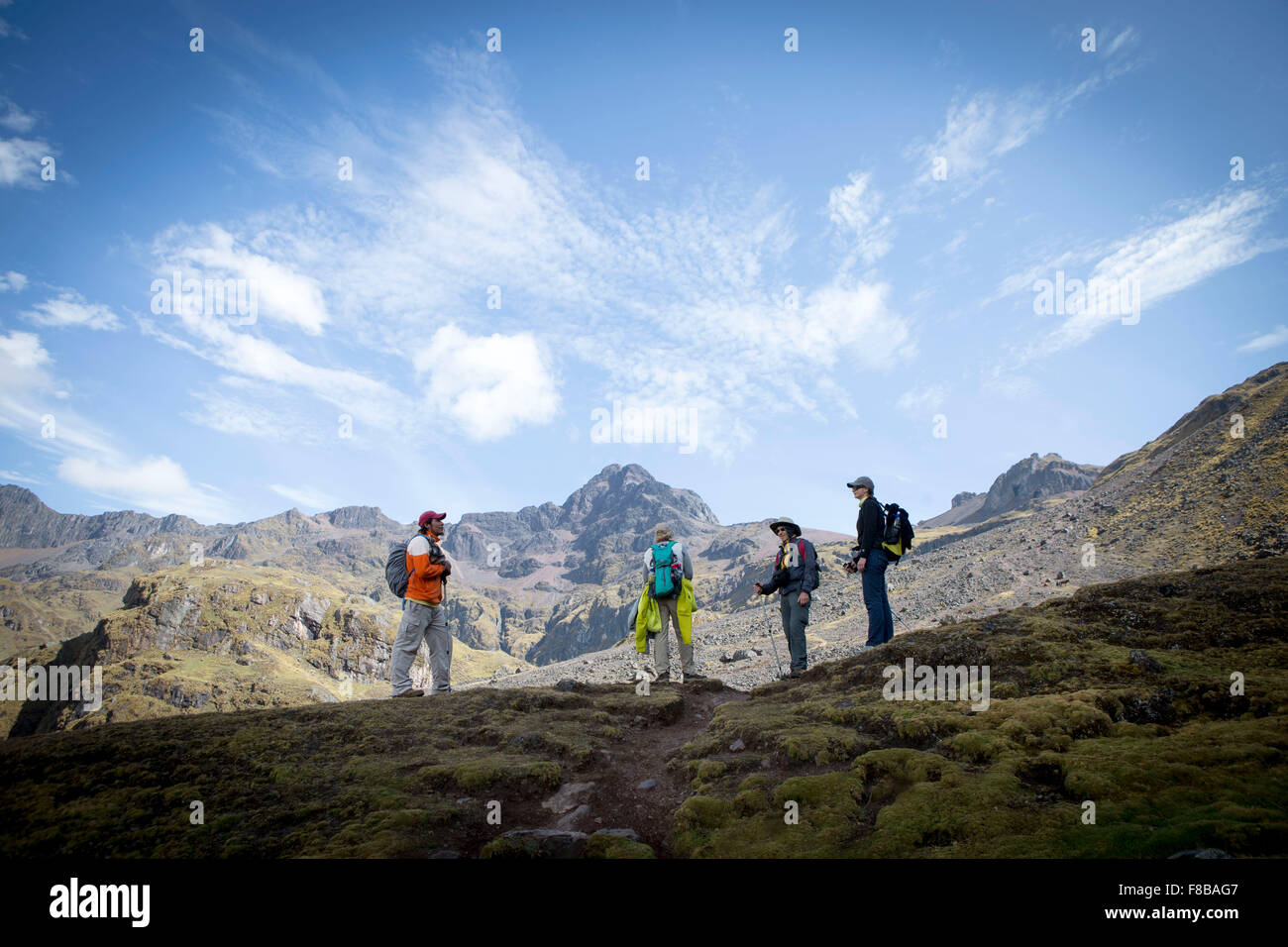 The Lares District of Peru. Tourists on a trek take a break - Stock Image