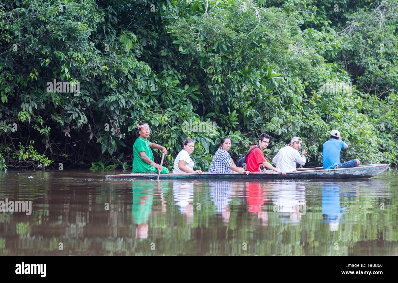 Cuyabeno protected forest reserve , Amazonia , Ecuador. Tourists on a canoe on Rio Aguarico near Samona Lodge - Stock Image