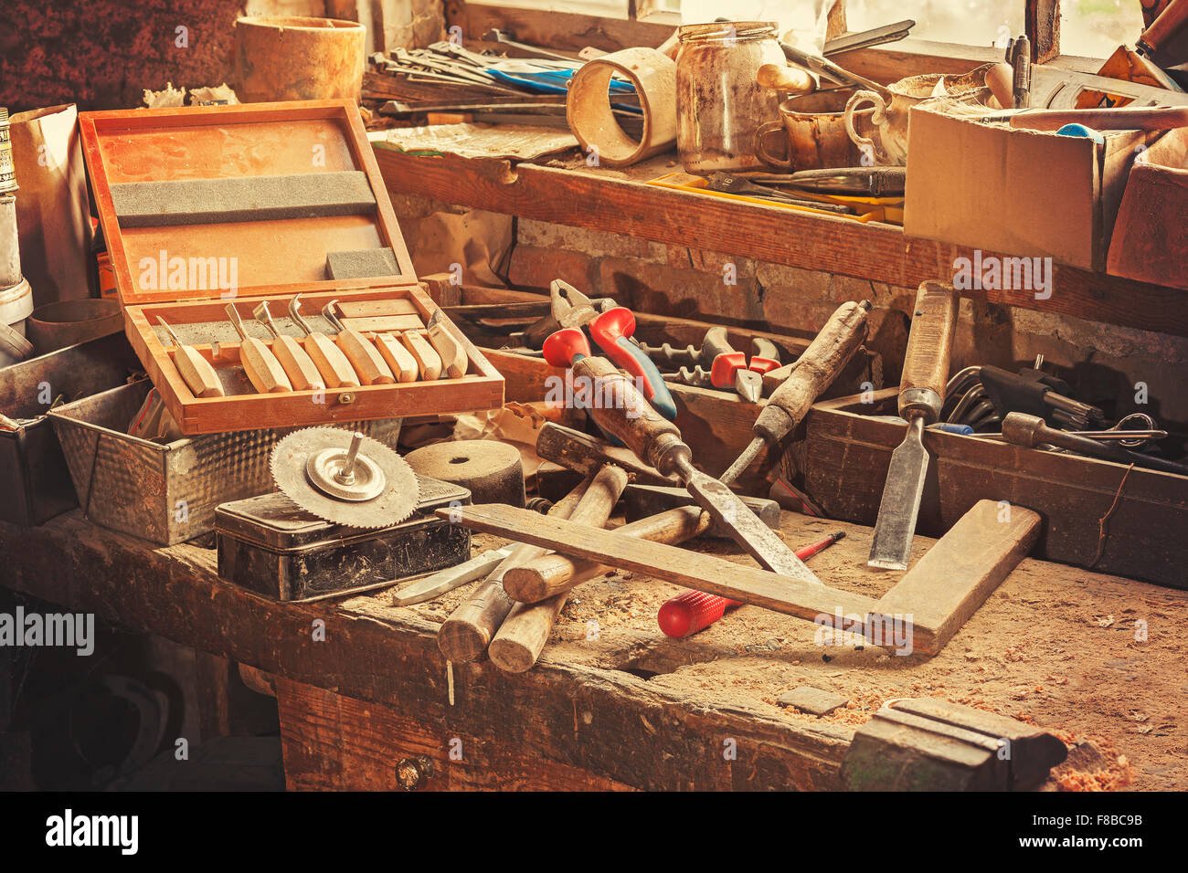 Retro stylized old tools on wooden table in a joinery. - Stock Image