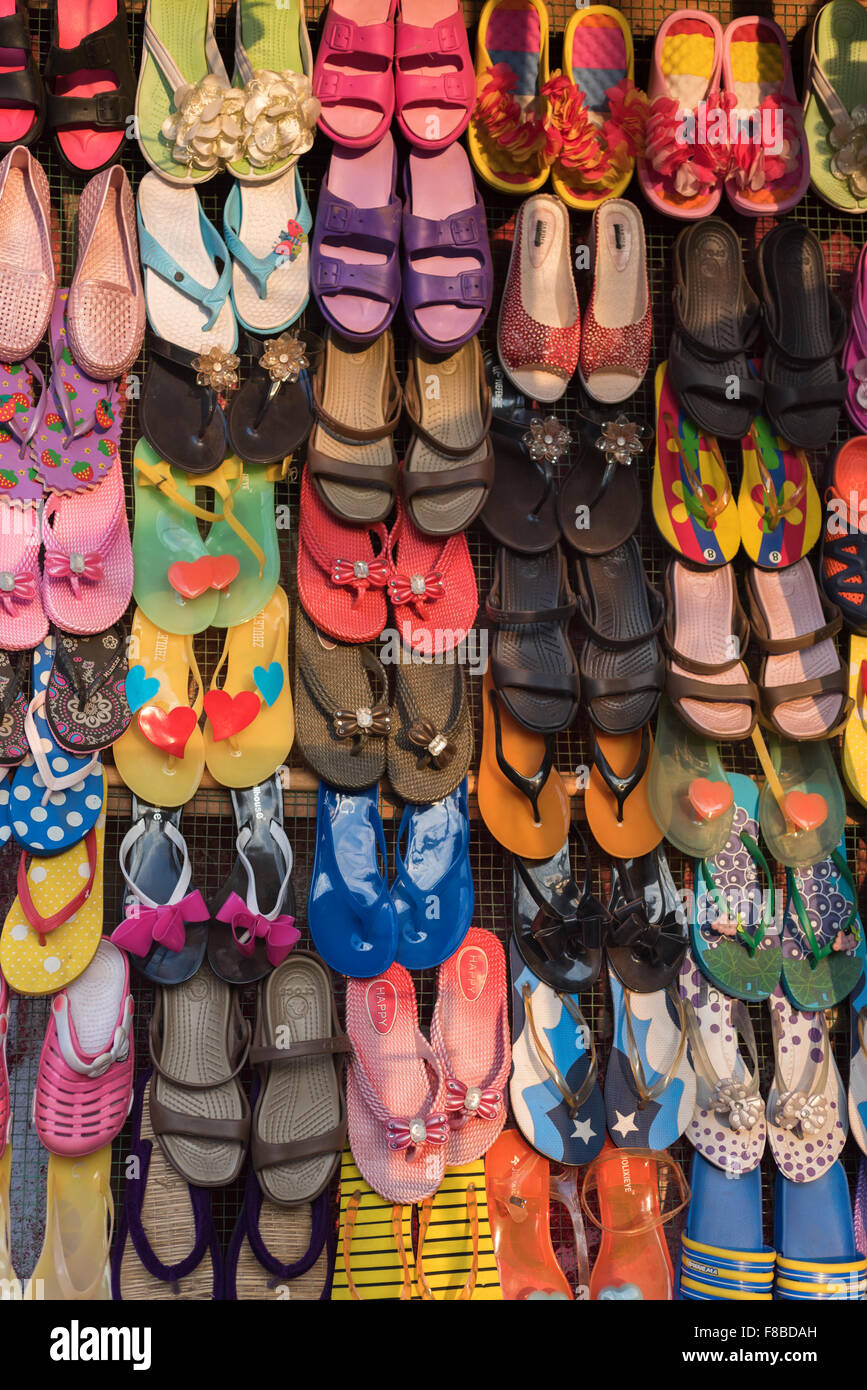 Colourful sandals on sale Colva Goa India - Stock Image