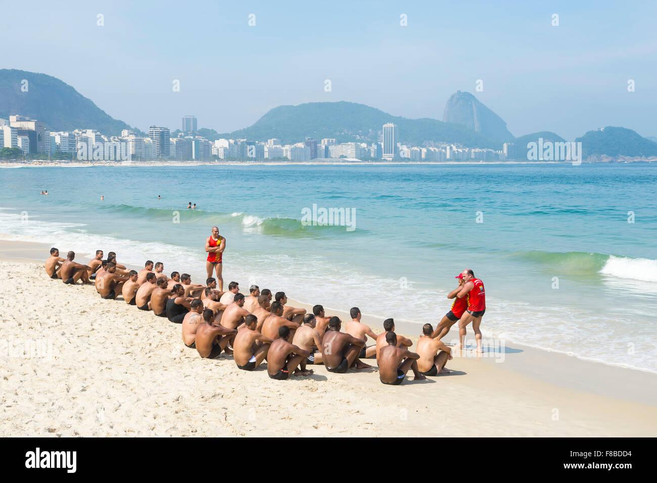 RIO DE JANEIRO, BRAZIL - NOVEMBER 10, 2015: Instructors lead a training course on Copacabana Beach. - Stock Image