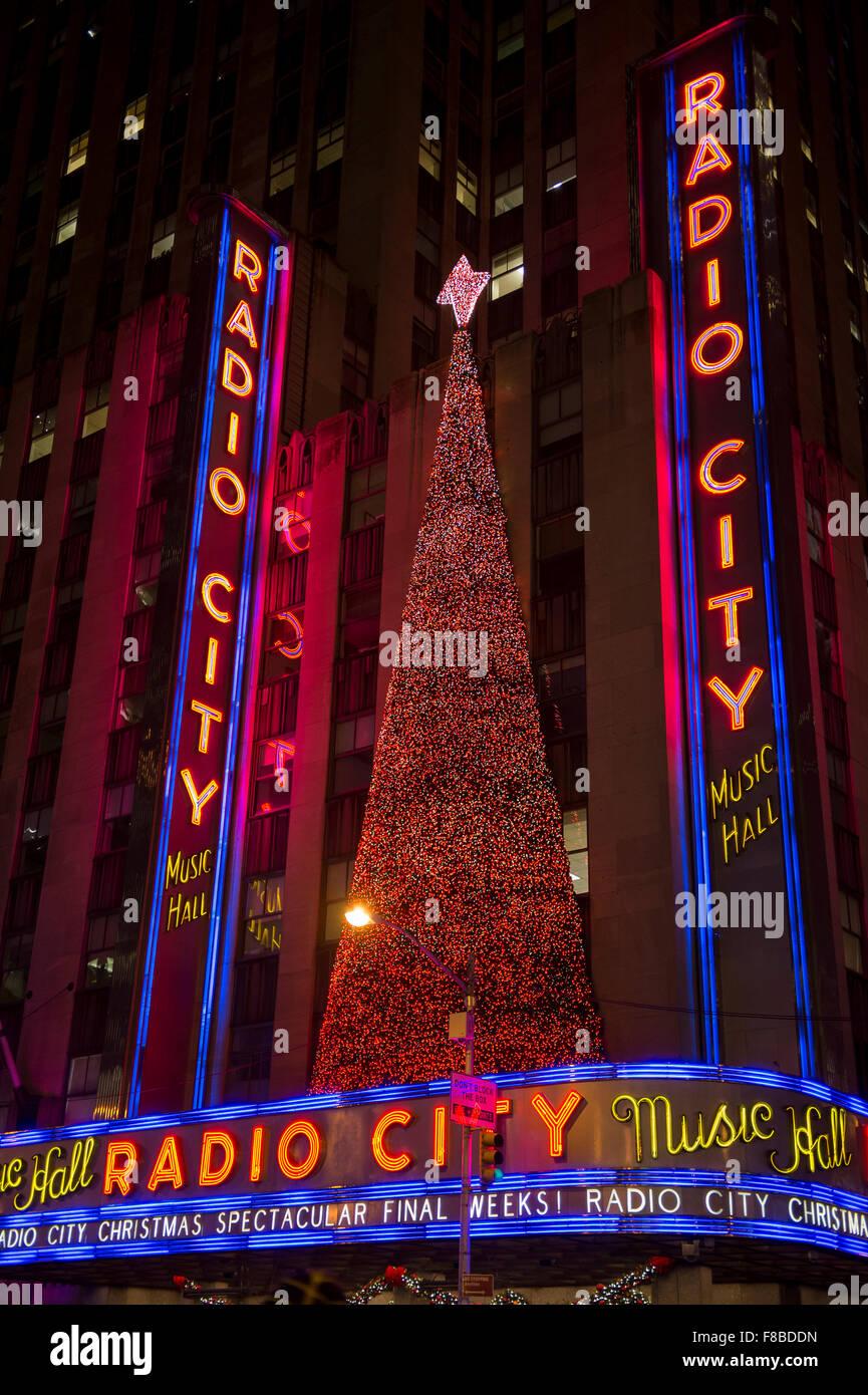 NEW YORK CITY, USA - DECEMBER 27, 2014: Christmas tree decorates the facade of the Radio City Music Hall. - Stock Image