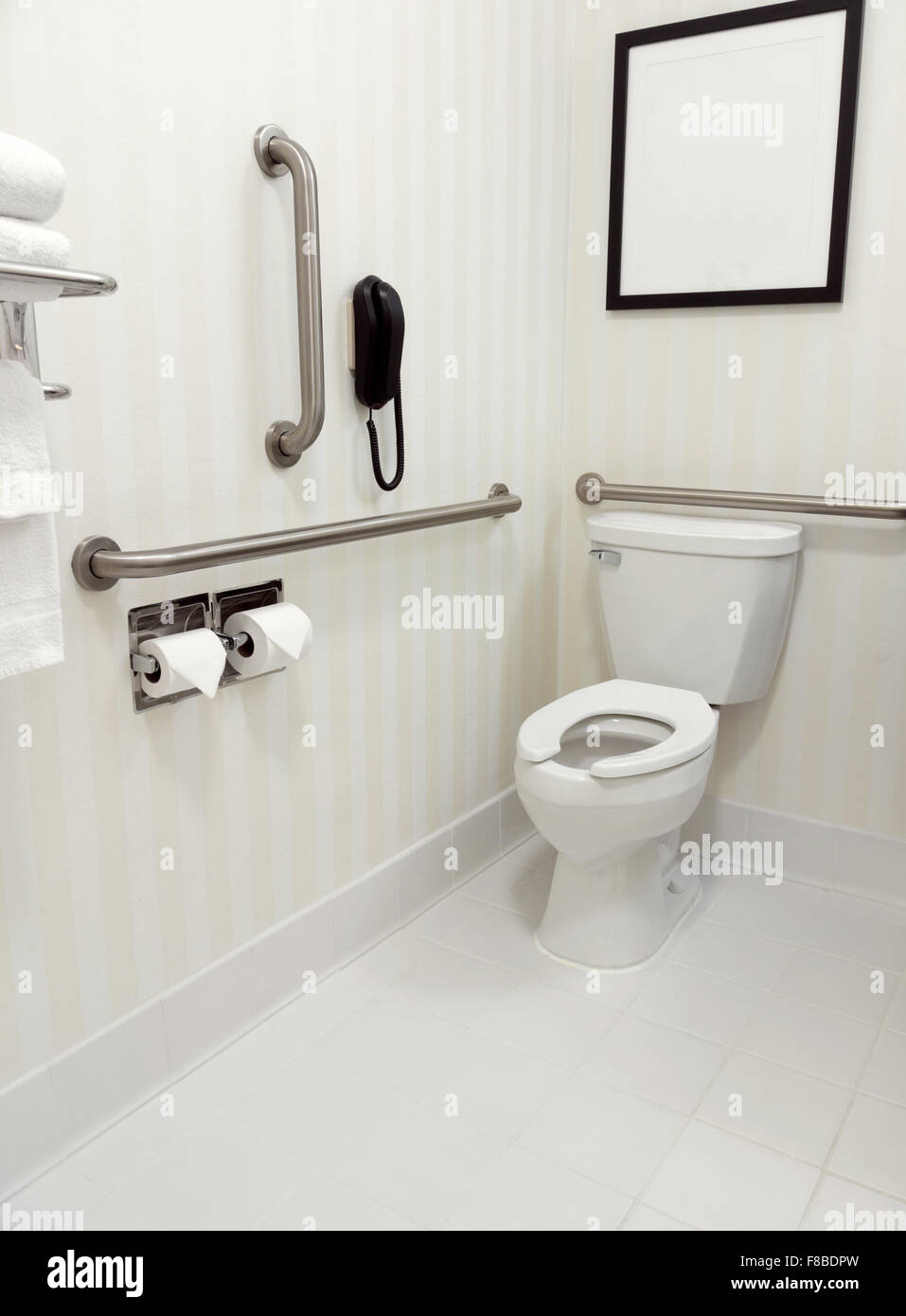 Handicapped disability access bathroom with grab bars and toilet - Stock Image