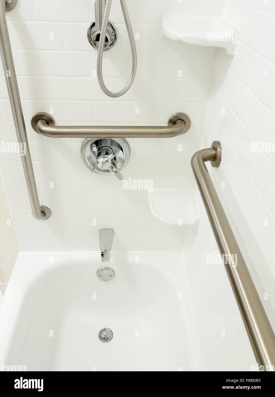 Disabled handicapped shower bathtub with grab bars - Stock Image