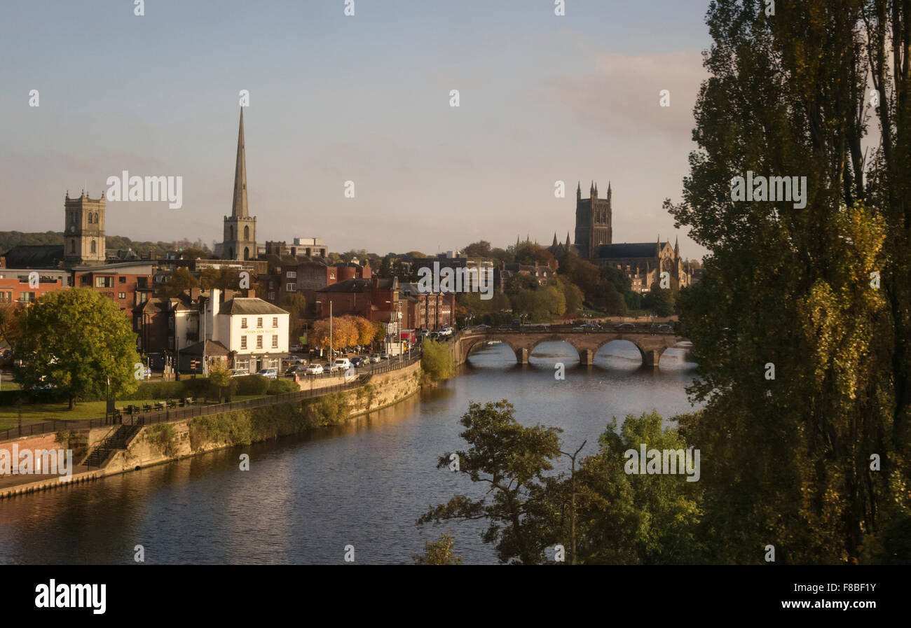 Worcester, West Midlands, UK. Evening view of the city from the train, showing the River Severn and the Cathedral - Stock Image