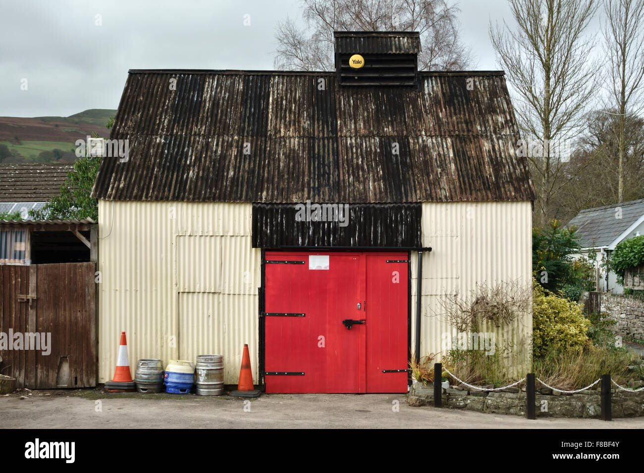 Llanbedr, mid Wales, UK. An old corrugated iron shed used as a garage - Stock Image