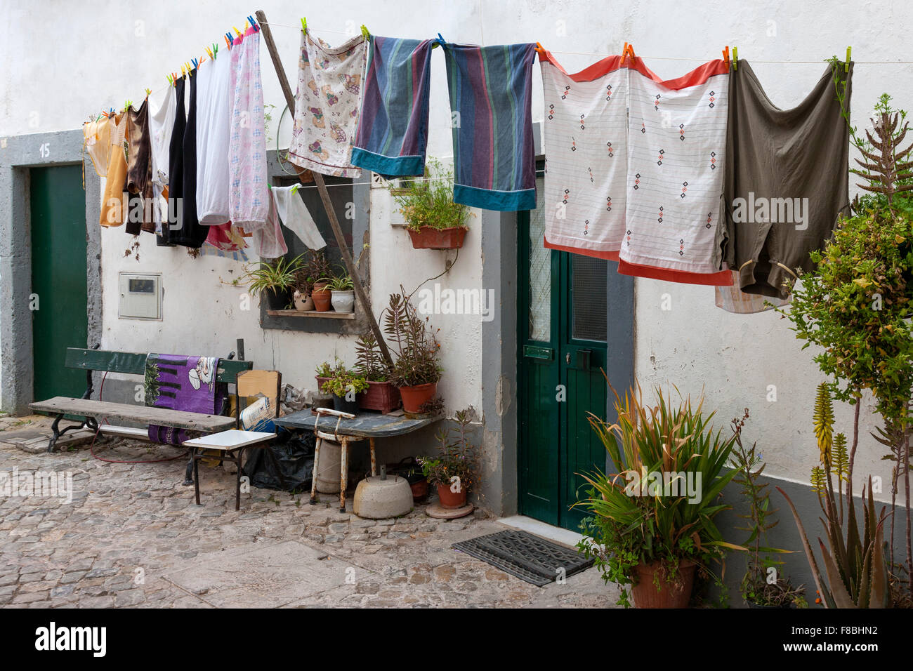 Washing on line with prop and pegs, Faro Portugal. - Stock Image