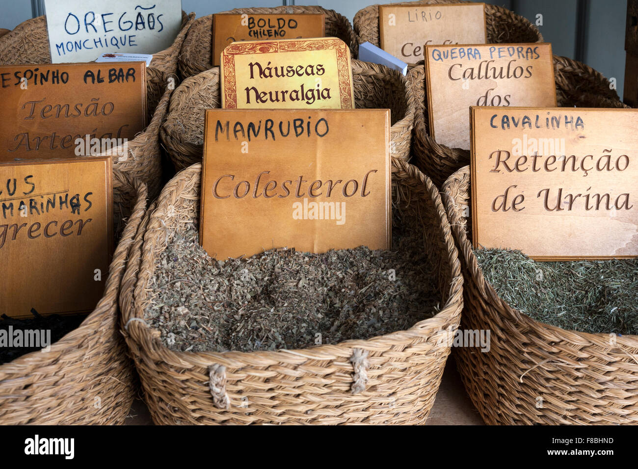 Herbal medicines in baskets. Portuguese language. Stock Photo
