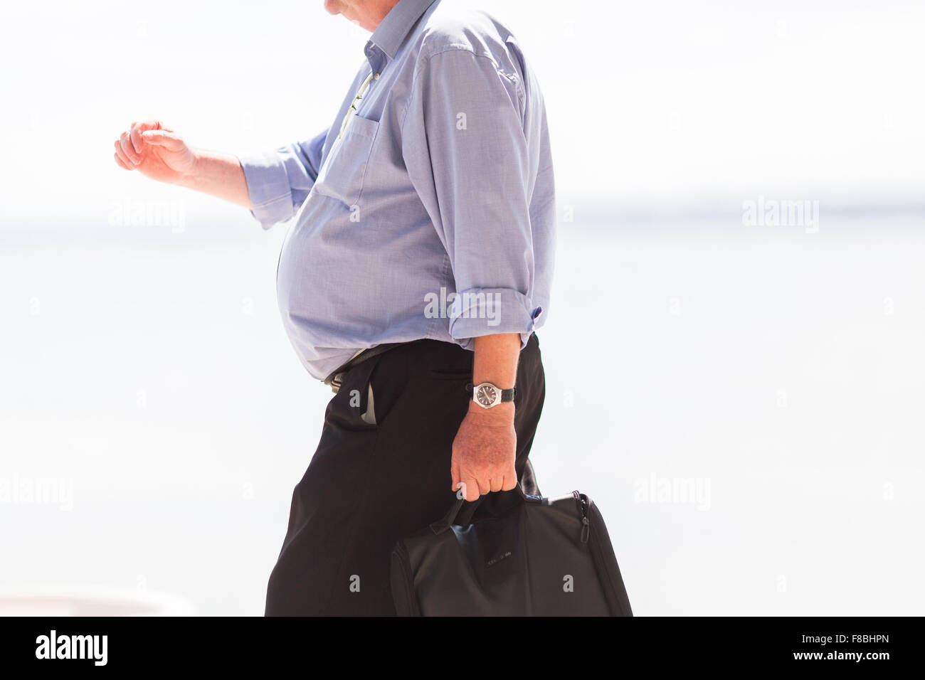 Overweight man. - Stock Image