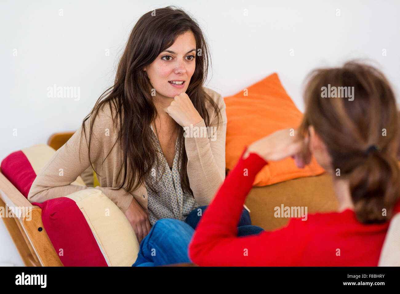 Two women having a conversation. - Stock Image