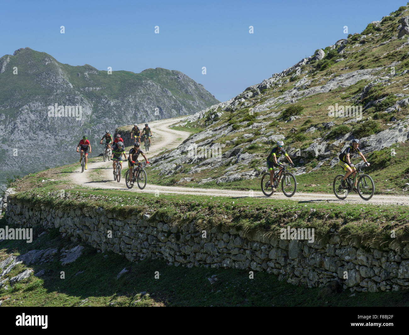 Mountain bikers in the Picos de Europa Mountains, near Sotres, Cantabria, Spain - Stock Image