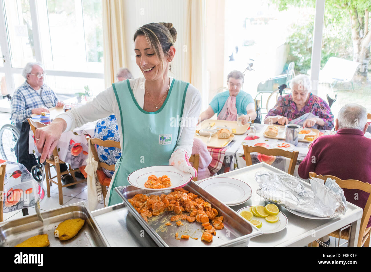 Elderly personns in the refectory of a residence for independent seniors, Dordogne, France. - Stock Image