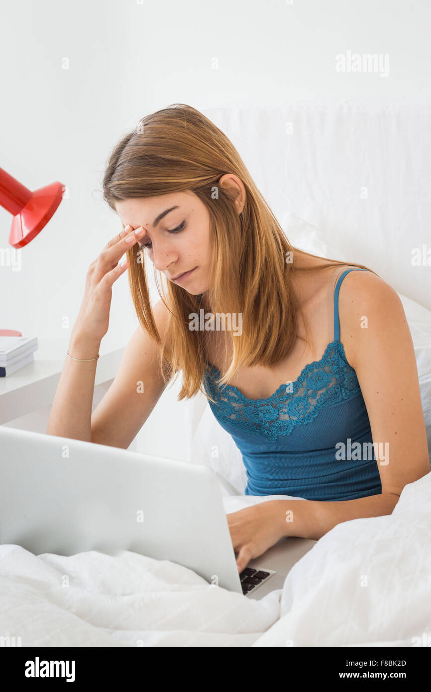 Young woman using laptop. - Stock Image