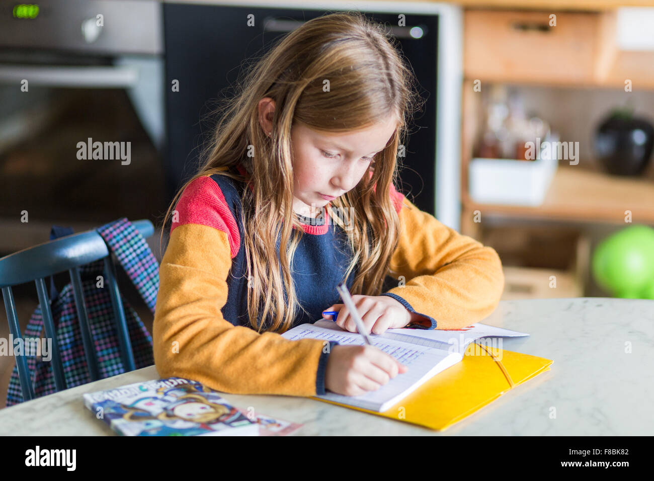 9-year-old girl doing her homework. Stock Photo