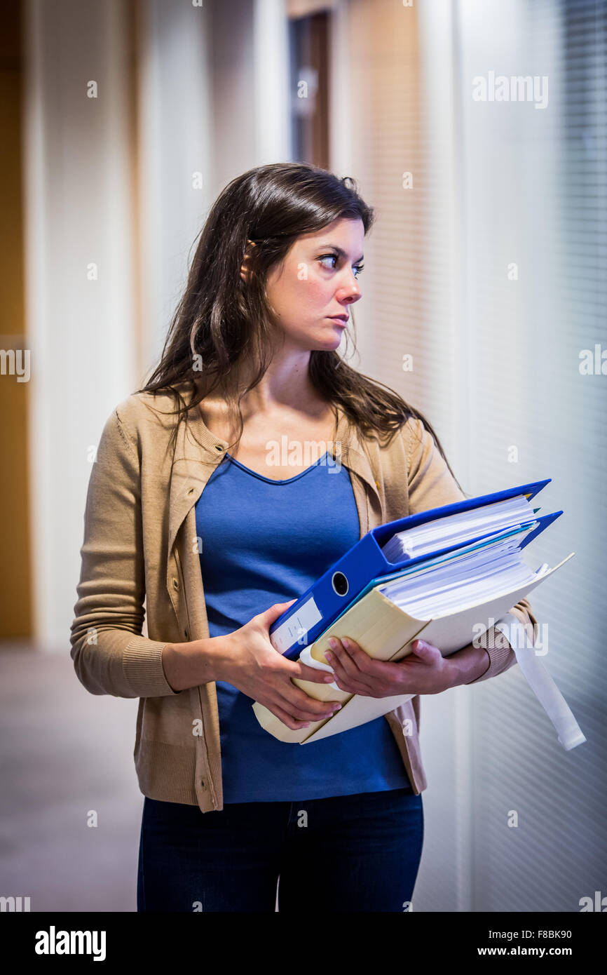 Tired woman at work. Stock Photo
