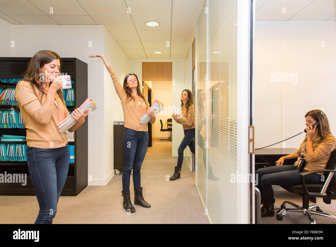 Active woman in the office to fight against physical inactivity. - Stock Image
