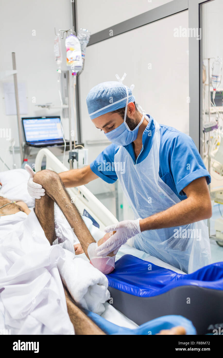 Physiotherapist with a patient in coma. - Stock Image
