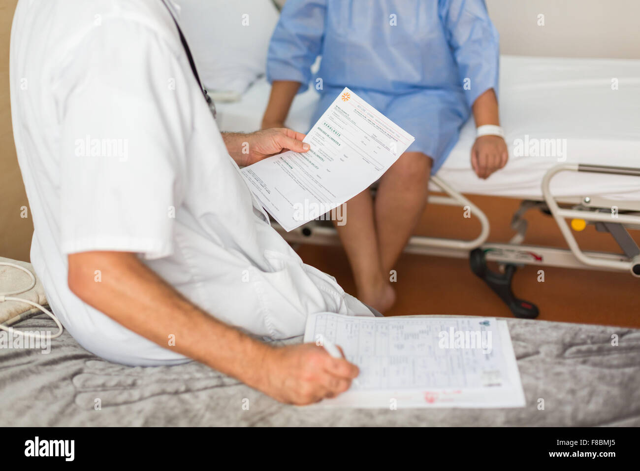 Woman in preoperative consultation with the anesthetist. - Stock Image