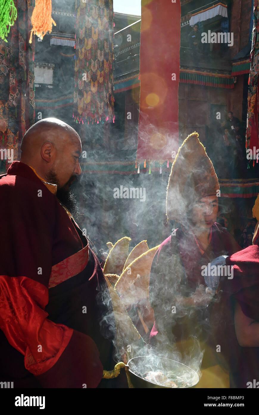 Xigaze, China's Tibet Autonomous Region. 8th Dec, 2015. Buddhists burn incenses during the 20th anniversary - Stock Image