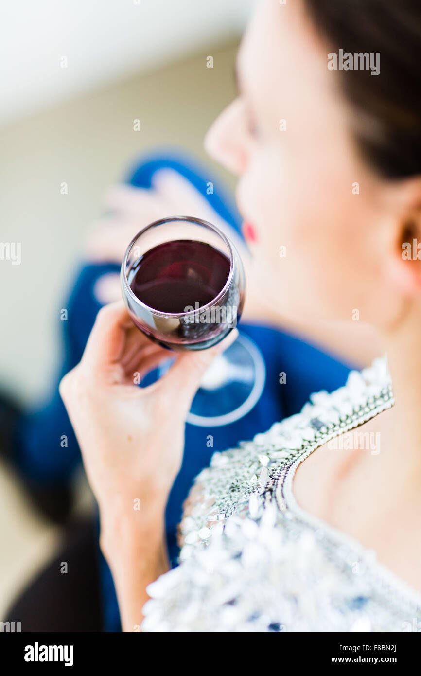Woman drinking a glass of red wine. Stock Photo