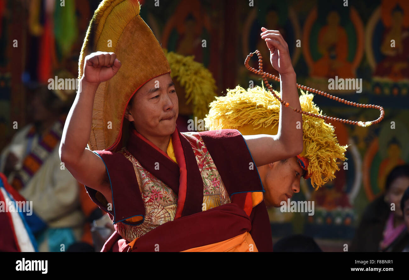 Xigaze, China's Tibet Autonomous Region. 8th Dec, 2015. A Buddhist performs during the20th anniversary of the - Stock Image