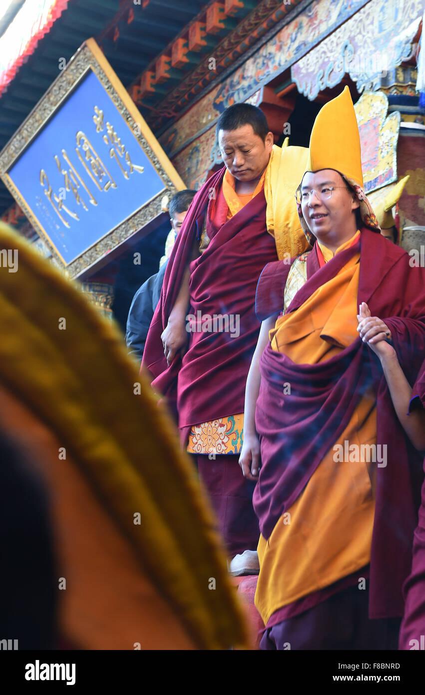 (151208) -- XIGAZE, Dec. 8, 2015 (Xinhua) -- Bainqen Erdini Qoigyijabu (R), the 11th Panchen Lama, one of the two - Stock Image