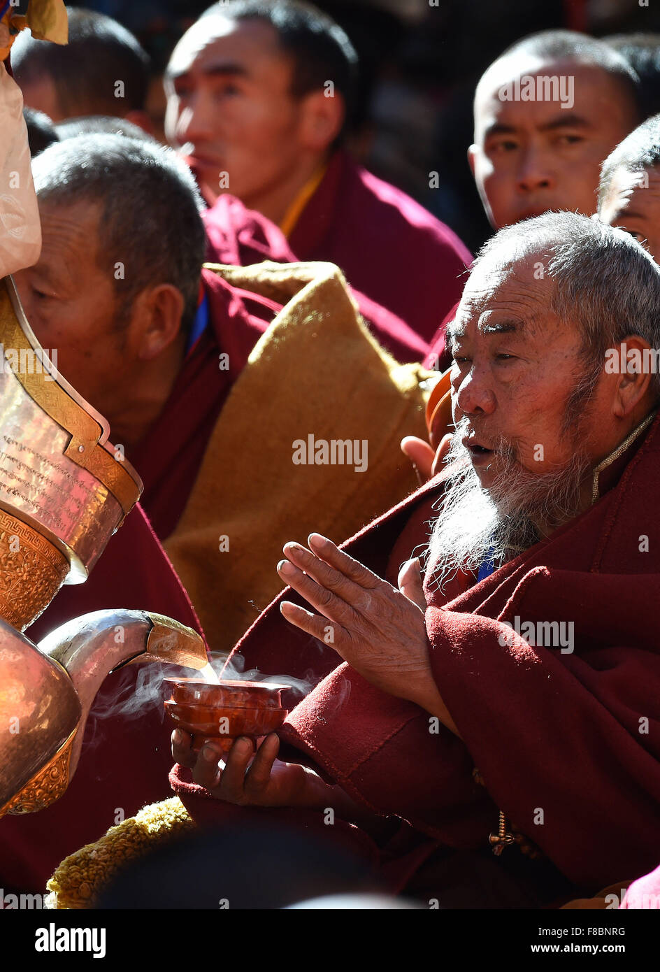 Xigaze, China's Tibet Autonomous Region. 8th Dec, 2015. Buddhists attend the 20th anniversary of the enthronement - Stock Image