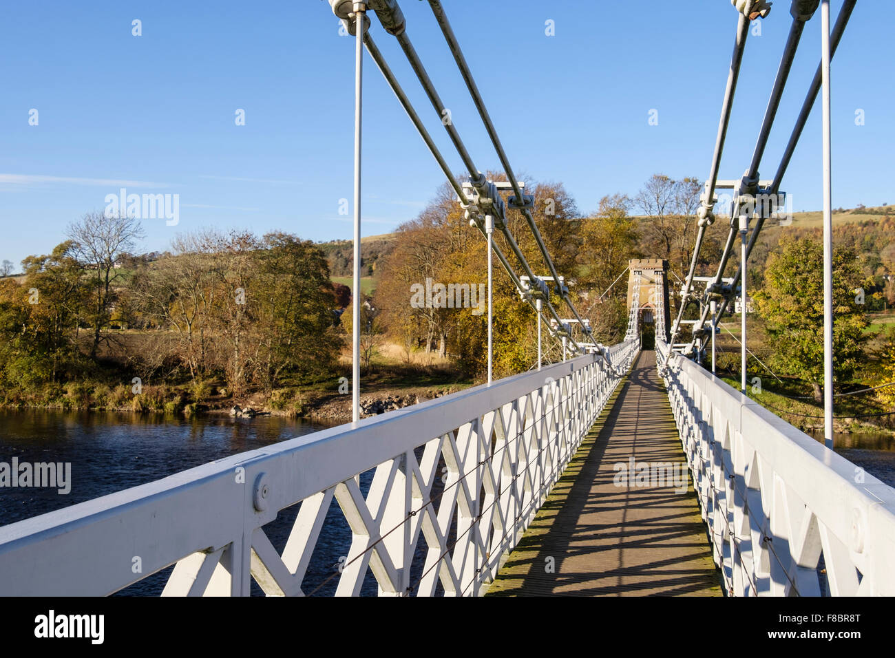 footbridgeLooking along Chainbridge footbridge route of Southern Upland Way across River Tweed. Melrose Scottish - Stock Image
