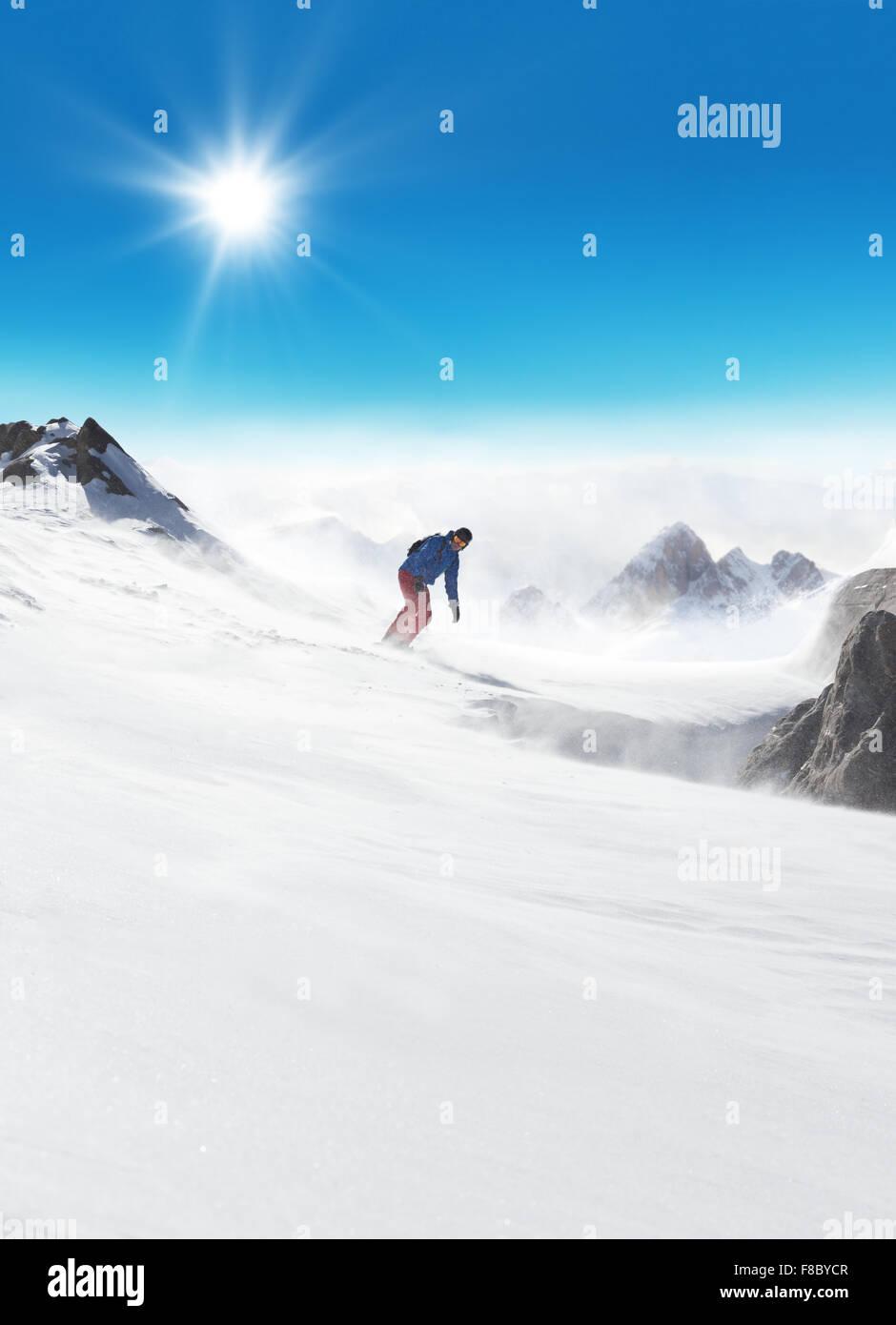 Snowboarder running down on piste - Stock Image