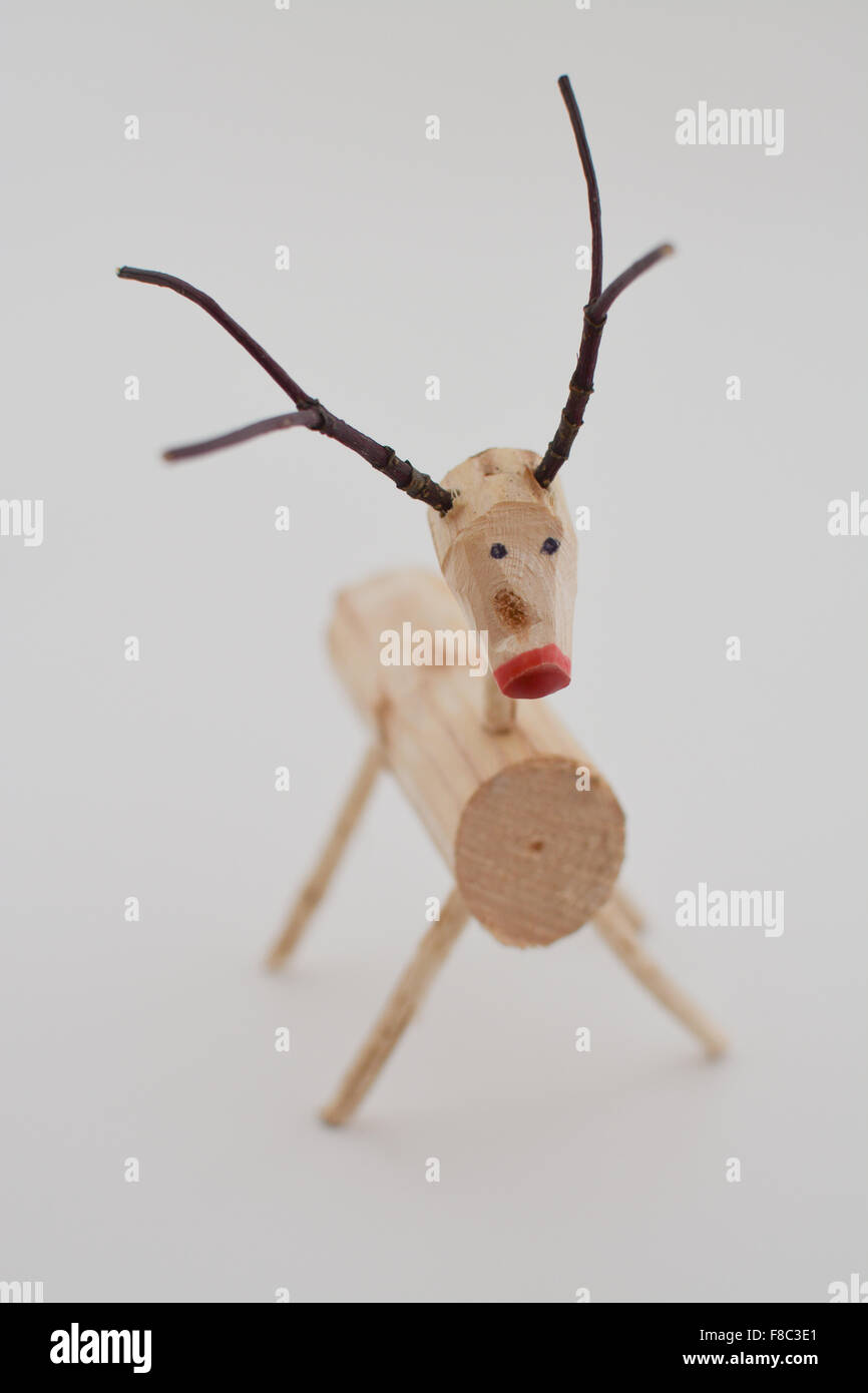handmade natural wooden reindeer christmas decoration against neutral white background stock image - Wooden Deer Christmas Decorations