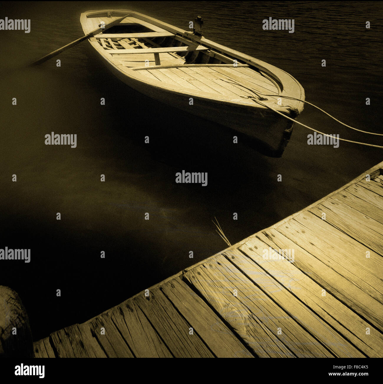 boat moored to quay - Stock Image