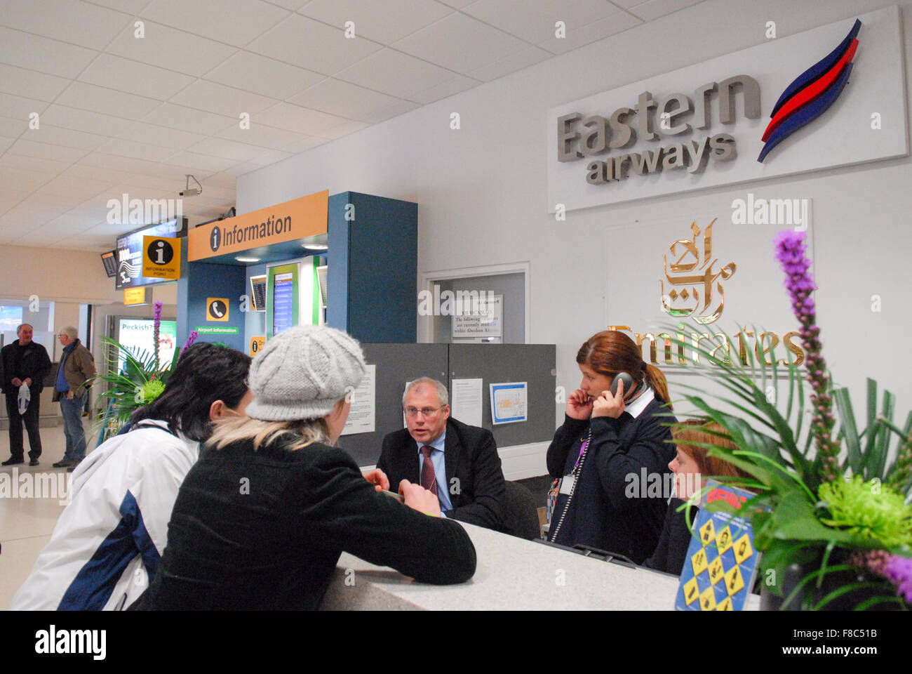 Emirates customer service desk at Aberdeen Airport in Aberdeen, Scotland. - Stock Image