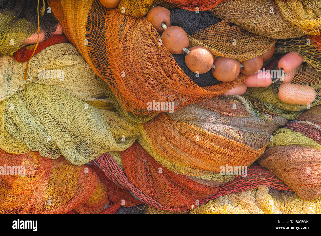 Fishing nets piled along the quay in the harbour at Catania, Sicily. - Stock Image