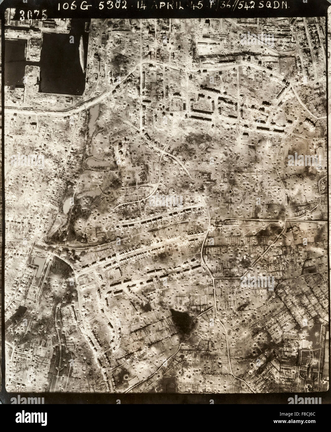 World War II aerial reconnaissance photograph of the port city of Kiel, Germany, showing the results of the massive - Stock Image