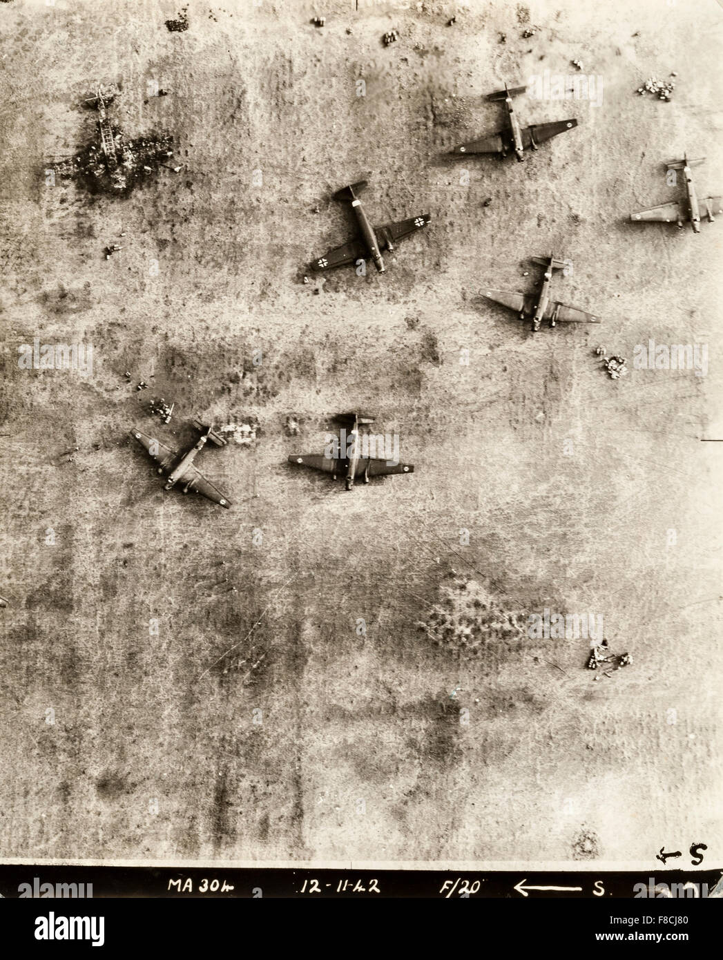 World War II RAF aerial reconnaissance photograph of a German airfield in North Africa after a bombing raid, showing - Stock Image